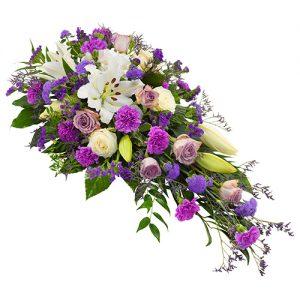 Rouwarrangement lila-paars wit