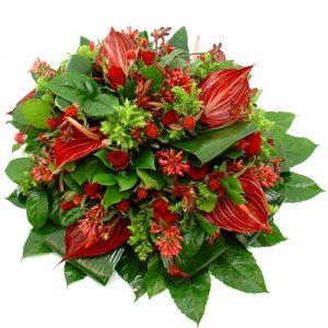 Rouwarrangement rode bloemen