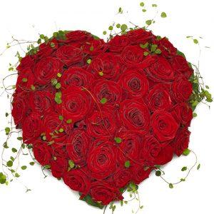 Rouwarrangement hart vorm rode rozen