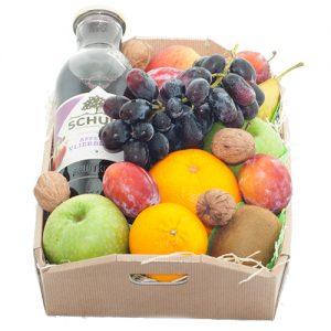 Fruitkistje met fles sap