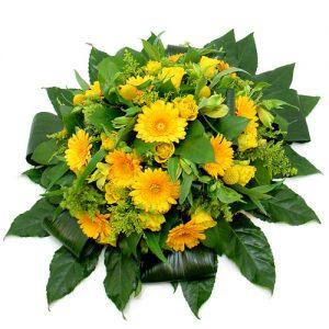 Rouwarrangement gele bloemen