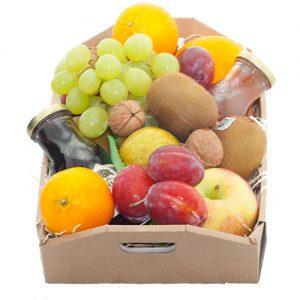 Fruitkistje met seizoensfruit en sap