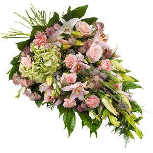 Rouwboeket van roze bloemen